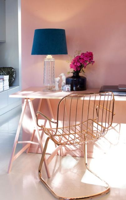Pink desk and elegant copper tube chair - via Pink Wallpaper