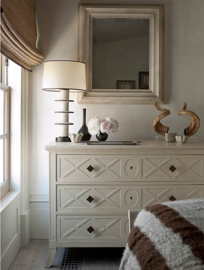 African Steenbok antlers on a bedroom sideboard, designed by Steven Gambrel