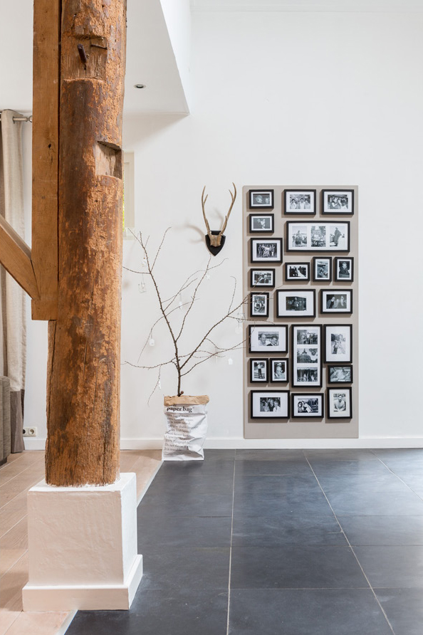 Black and white gallery wall in a Dutch house, photographed by Hans Mossel