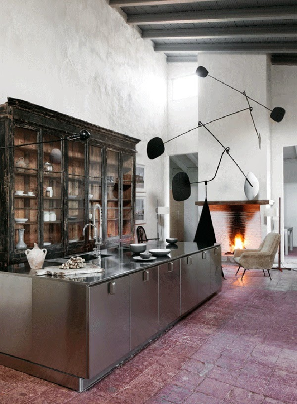 I love the contrast of the antique cupboard, the industrial steel island and the light fixture by Design Icon Serge Mouille - via Belle Vivir