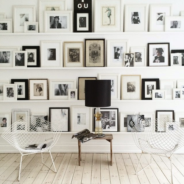 Lots of frames and two Bertoia chairs in the home of Danish novelist Annika von Holdt - via My Scandinavian Home