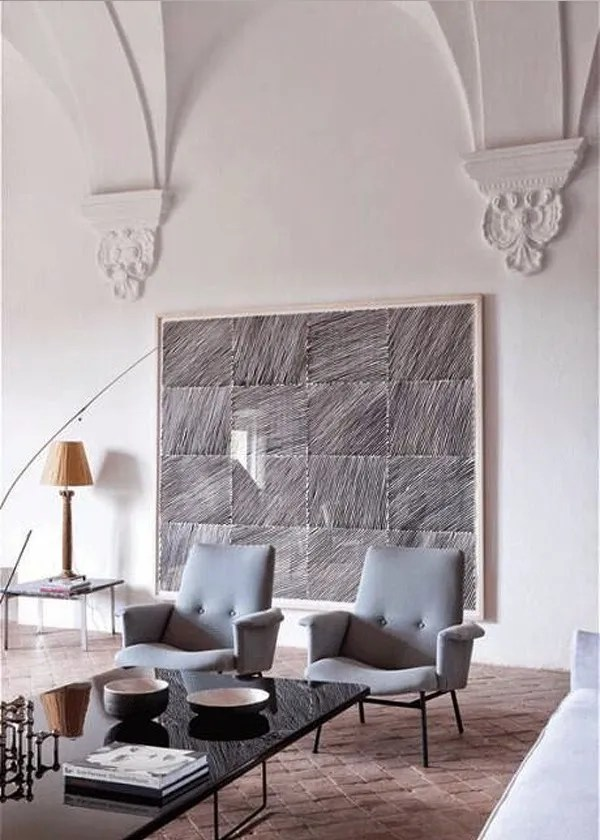 Mid Century armchairs by Gio Ponti and painting in a 15th century palace in Girona, Spain - via Belle Vivir