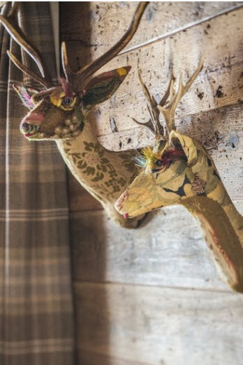 deer heads made out of patchworked tapestry fabric instead of real deer  - via Todaloos