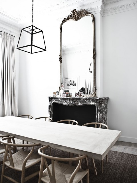 Wishbone Chairs and a minimal chandelier in this ornamented room - via Coco Lapine