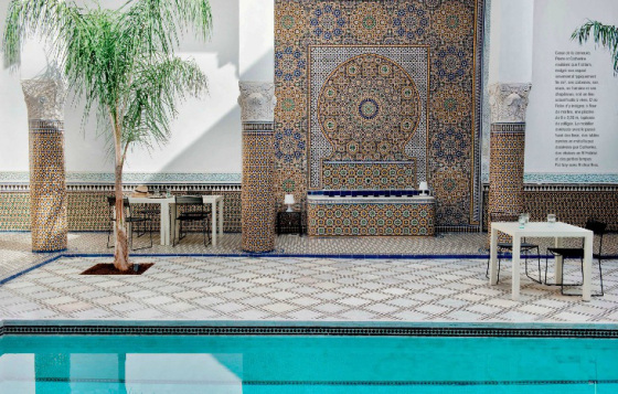 This home in Fez, Morocco has a beautiful pool with traditional tiling contrasting nicely with the contemporary tables and chairs - via Cote Sud
