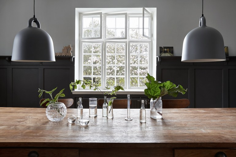Beautiful in its simplicity - old glass bottles and jars with a few garden greens - via Coco Lapine
