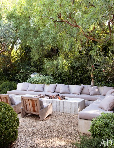 Concrete outdoor firepit in actor Patrick Dempsey's Malibu home - via Architectural Digest