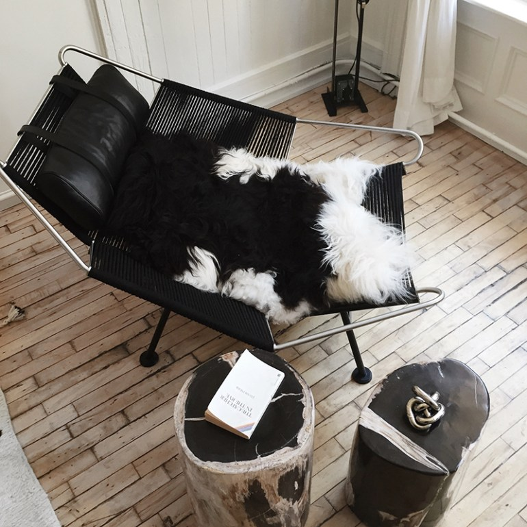 A sheepskin from Iceland in a vintage Hans Wegner chair in NY appartment shop The Line - via Fashion Squad