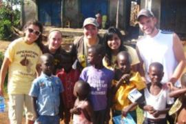 52317ad851533 Volunteers with the children 300x225 min min KVCDP empowers the youth of Kenya