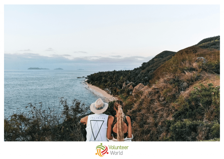 couple on hill looking at sea
