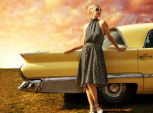 woman-beside-vintage-car