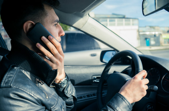 young man using phone while driving