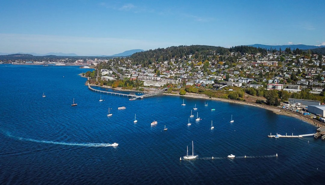 Bellingham's Taylor Dock and the Fairhaven Historic District viewed from above the blue waters of Bellingham Bay