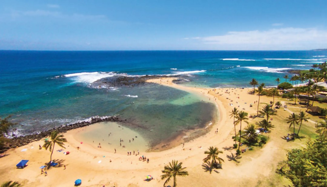 Hawaii's Poipu Beach is shaped like a whale, with a sandy tail extending into the water