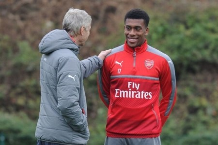 Alex Iwobi in training with Arsenal manager Arsene Wenger