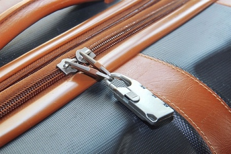 A luggage secured with a padlock