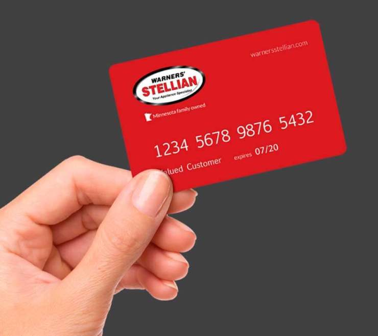hand holding Warners' Stellian Credit Card