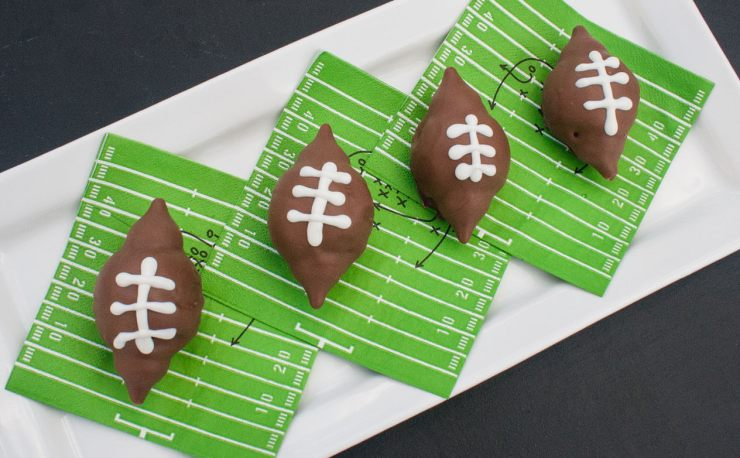 football brownie treats on football field napkins