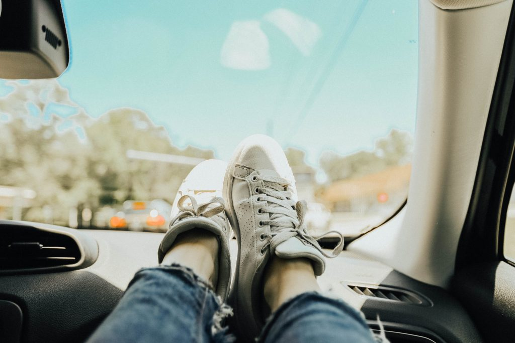 road trip with shoes on the dash