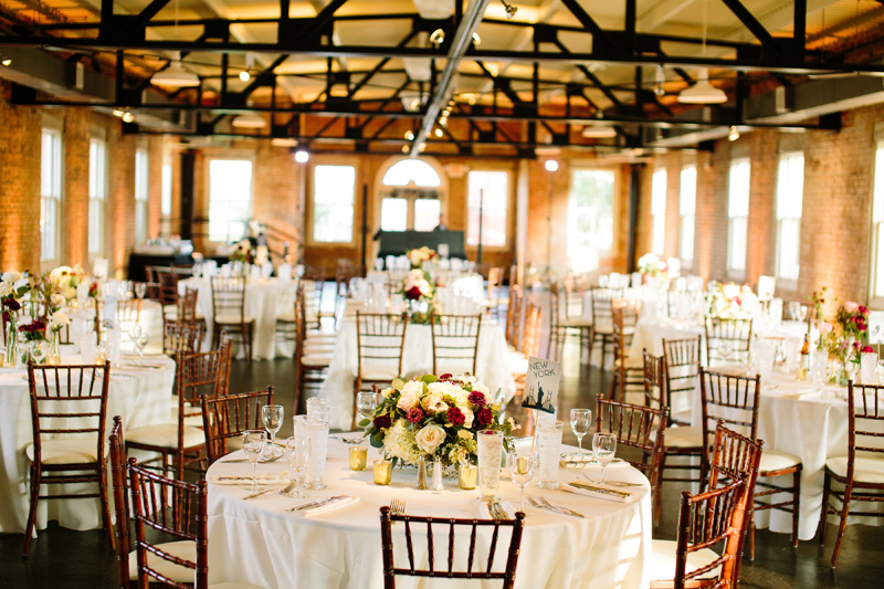 Image of interior of The Filter building Dallas Wedding Venue. Tables and chairs with rose centerpieces.