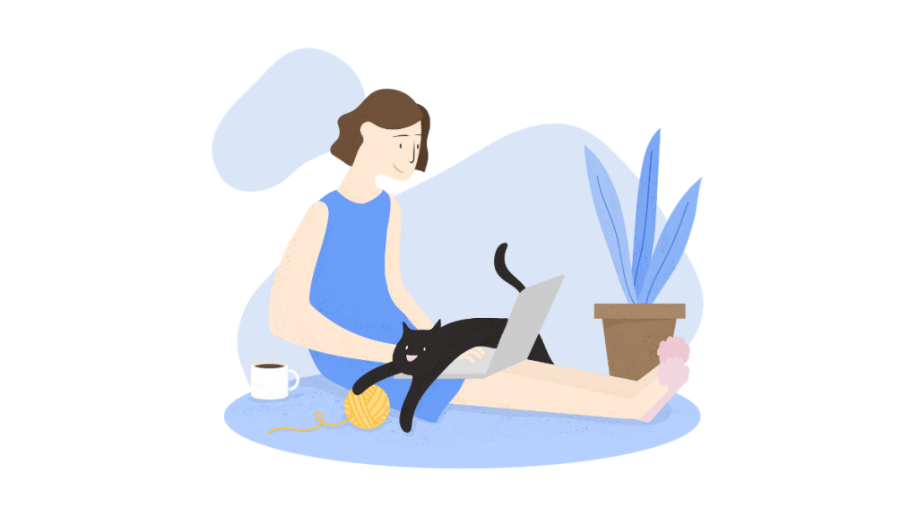 girl working on laptop with cat on lap
