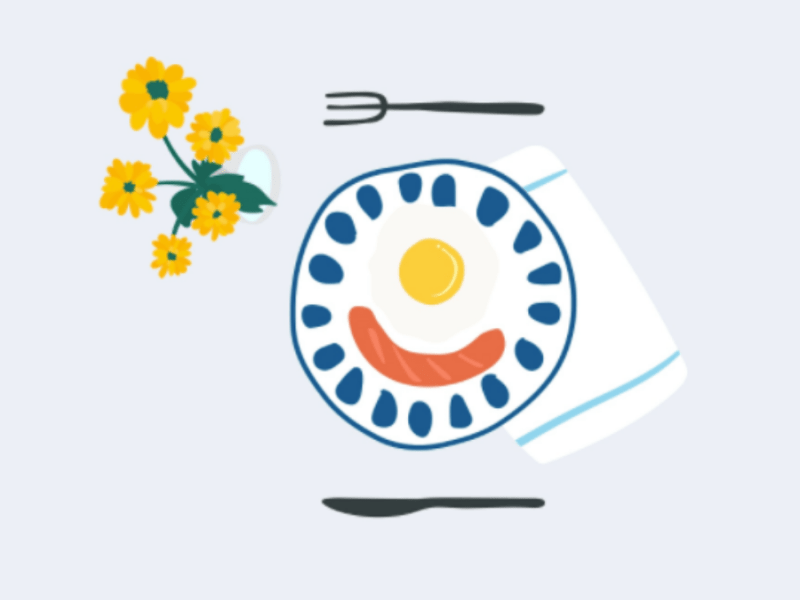 eggs and sausage breakfast with flowers