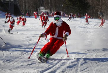 Skiing Santas ho-ho-hold court at ski resort's annual bash