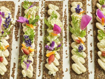 Plenty of almonds is how to dress up crackers and a spread