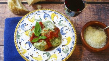 Tuscan Spinach and Ricotta Dumplings topped with marinara