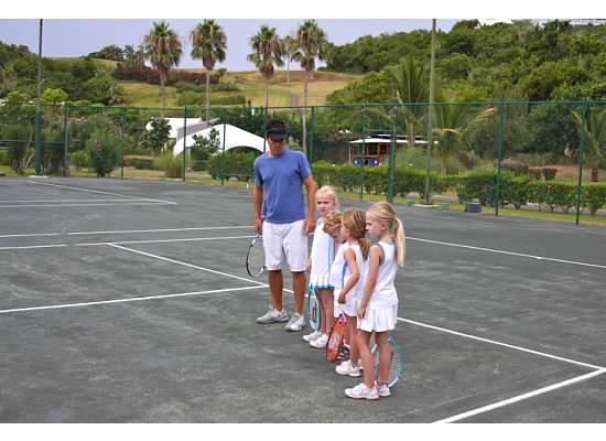 "Our kids playing tennis with friends visiting and ""coach"" Jon Pastel"