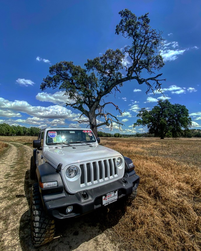 This Jeep Wrangler has a 4-cylinder turbo engine that gives it an enormous amount of power, great acceleration, and the ability to obtain 25mpg on the highway. It is available for sale from West Mitsubishi in Orland, California