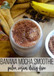 A mason jar filled with banana mocha smoothie with fresh bananas, raw cacao and coffee beans.