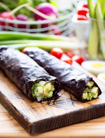 Clean-Eating Avocado Nori Rolls | There's no sense in changing your food choices in the coming year if you don't have some delicious and nutritious recipes to help you reach your goals. After all, healthy food does NOT have to taste like cardboard. Full of flavor and healthy fats from eggs and avocado, these simple avocado nori rolls are light, yet satisfying. They're quick and easy to whip up, too! | WildernessFamilyNaturals.com