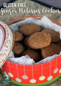 A photo of a cookie tin filled with gluten-free ginger molasses cookies made grain-free and refined sugar-free.
