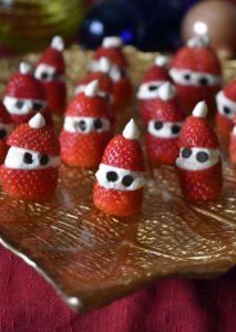 Sugar-Free Strawberry Santas {a perfectly adorable Christmas snack!} | I love these adorable costumed morsels for the Christmas holidays. They're just so cute and delicious! A platter of these sugar-free strawberry Santas will disappear like magic. Now you see them; now you don't! | WildernessFamilyNaturals.com