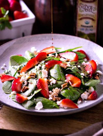 Strawberry & Spinach Salad With Naturally Sweetened Balsamic Dressing | A strawberry and spinach salad with naturally sweetened balsamic dressing satisfies a craving for greens and berries after a long winter. The woodsy acidity of balsamic vinegar brings out the brightness of the strawberries -- and then it's all balanced with creamy goat cheese. | WildernessFamilyNaturals.com