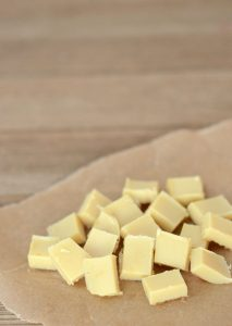 DIY White Chocolate Chips {dairy-free, soy-free} | With just 3 ingredients you can create your own white chocolate chips without the soy lecithin and hydrogenated oils. You control the ingredients, the sugar, and get the satisfaction of making a specialty ingredient in your own kitchen! | WildernessFamilyNaturals.com