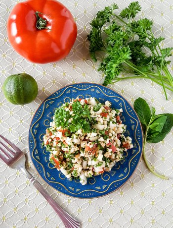Low-Carb Paleo Tabbouleh | In this twist on traditional Tabbouleh, riced cauliflower stands in for bulgur wheat. This Low-Carb Paleo Tabbouleh is a crowd-pleasing dish for potlucks, parties, and barbecues. It's also grain-free, gluten-free, dairy-free, egg-free, and nut-free! | WildernessFamilyNaturals.com