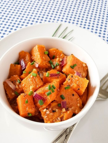Paleo Sweet Potato Salad With A Tangy Garlic Vinaigrette | This Paleo Sweet Potato Salad is a refreshing change from regular potato salad. It's bright, full of flavor, grain-free, gluten-free, and so pretty! With 3 easy ways to cook the sweet potatoes, you can whip up this easy side dish in minutes. What a lovely salad to transition from summer to autumn! | WildlyOrganic.com