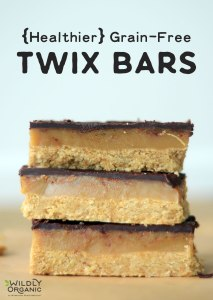 Three grain-free twix bars stacked on top of each other on a table.