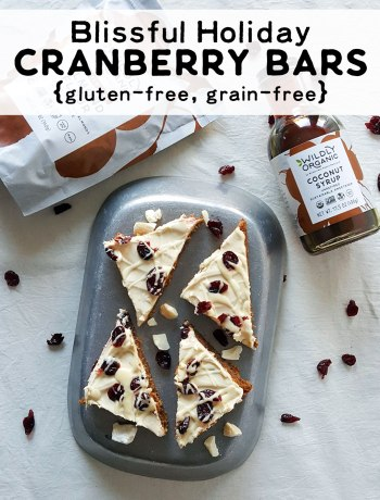 A photo of gluten-free and grain-free blissful cranberry bars topped with frosting and cranberries on a platter.