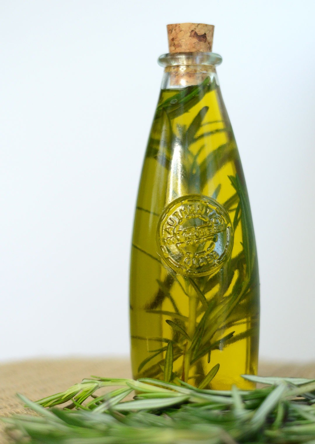 Herb-infused oil looks like a gourmet treat, but iseasy to make and can be a wonderfully unique gift. With a high quality olive oil and a bit of planning ahead, you can learn how to make herb-infused olive oil with any of your favorite herbs or spices -- like basil, rosemary, thyme, chilies, or garlic! Herb-infused oils look beautiful and taste delicious in cooking!