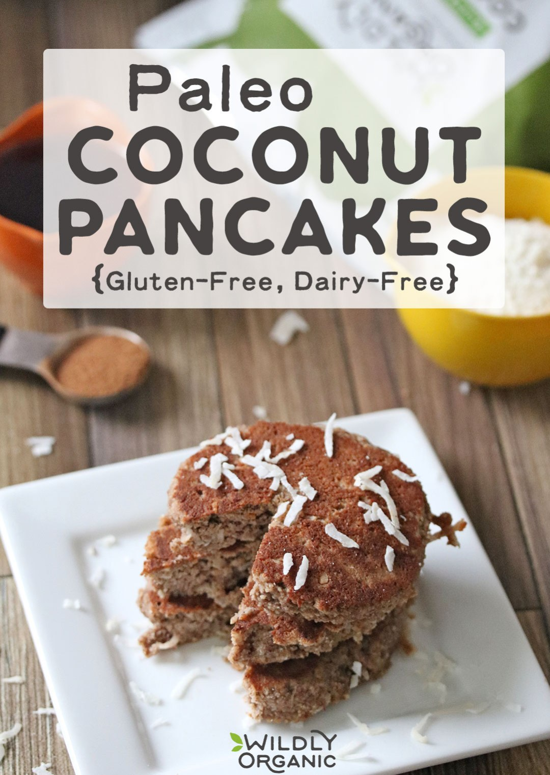 Photo of paleo coconut pancakes on a plate, with coconut sprinkled on top