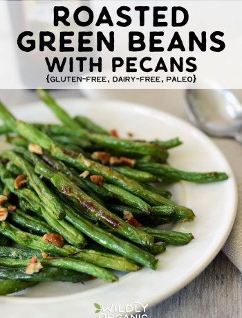 Photo of roasted green beans with pecans on a serving dish.