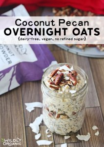 A mason jar filled with coconut pecan overnight oats topped with pecans and Wildly Organic coconut flakes.