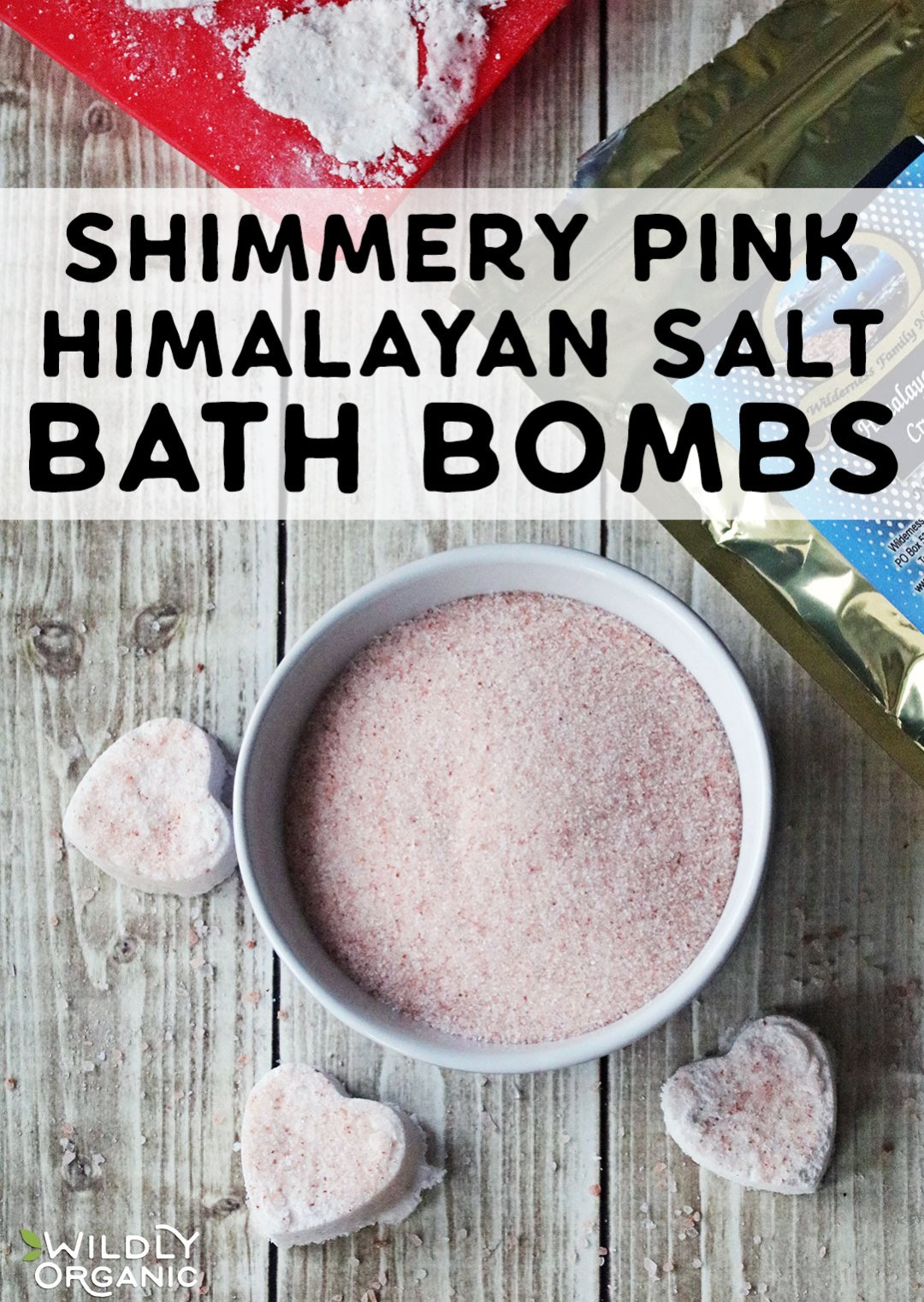 Photo of a bowl of salt with heart shaped bath bombs.