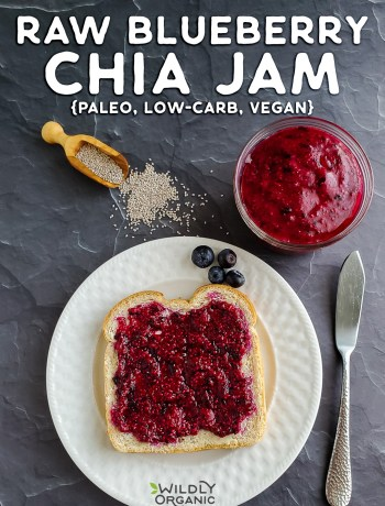 A photo of a piece of toast on a plate with raw blueberry chia jam on top with a bowl of chia jam on a table.