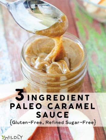 A jar with nut butter paleo caramel sauce with a spoon dipping into it.
