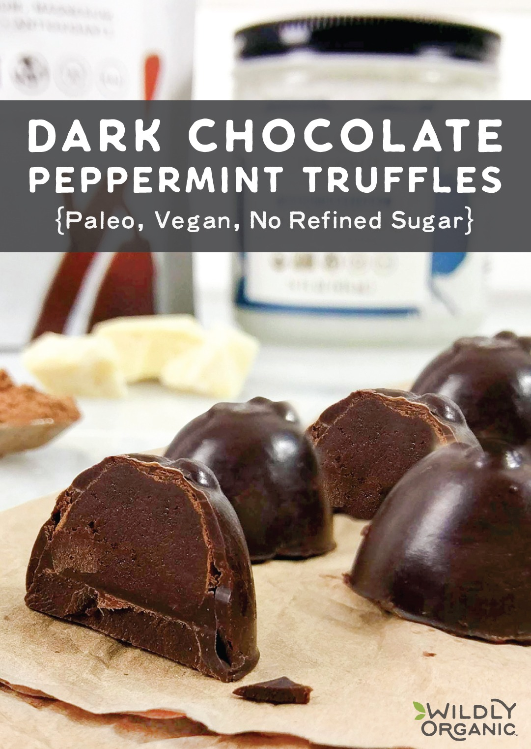 Dark chocolate peppermint truffles with a chocolate coating on a table with Wildly Organic Raw Cacao Butter in the background.