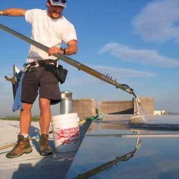 Window Cleaning Machine, a WaterFed system, used to clean solar Panels.